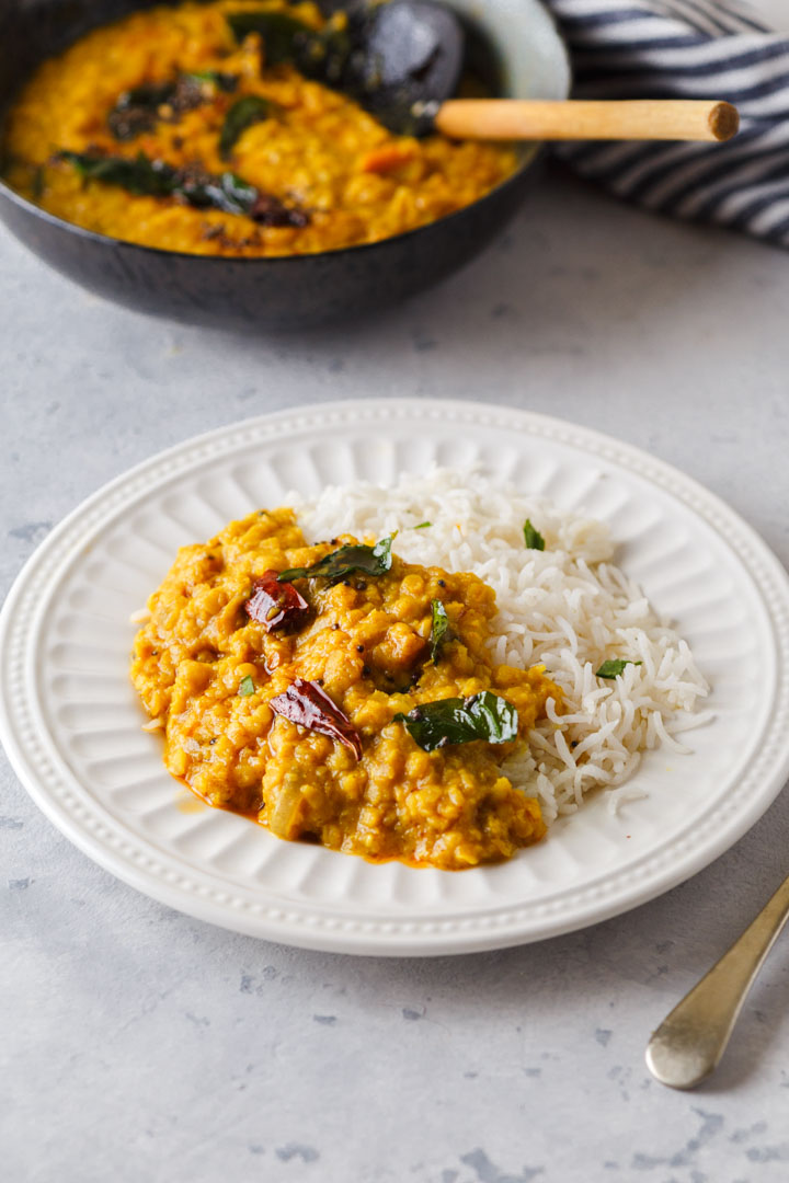 red lentil dal in a plate with rice