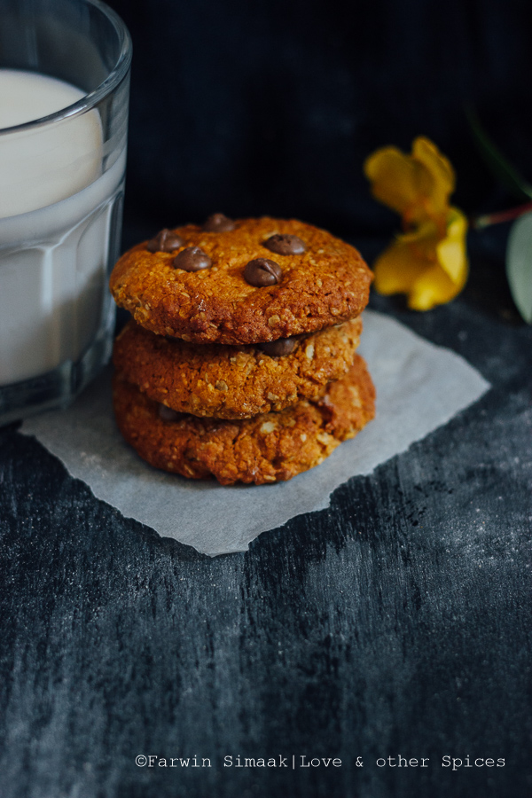 healthy anzac cookies with a glass of milk