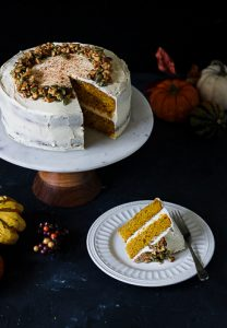 Gluten free pumpkin layer cake with cream cheese frosting slice on a plate