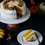 gf pumpkin layer cake with cream cheese frosting slice on a plate