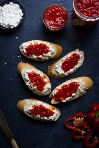 sweet chili pepper jelly with cheese on baguette