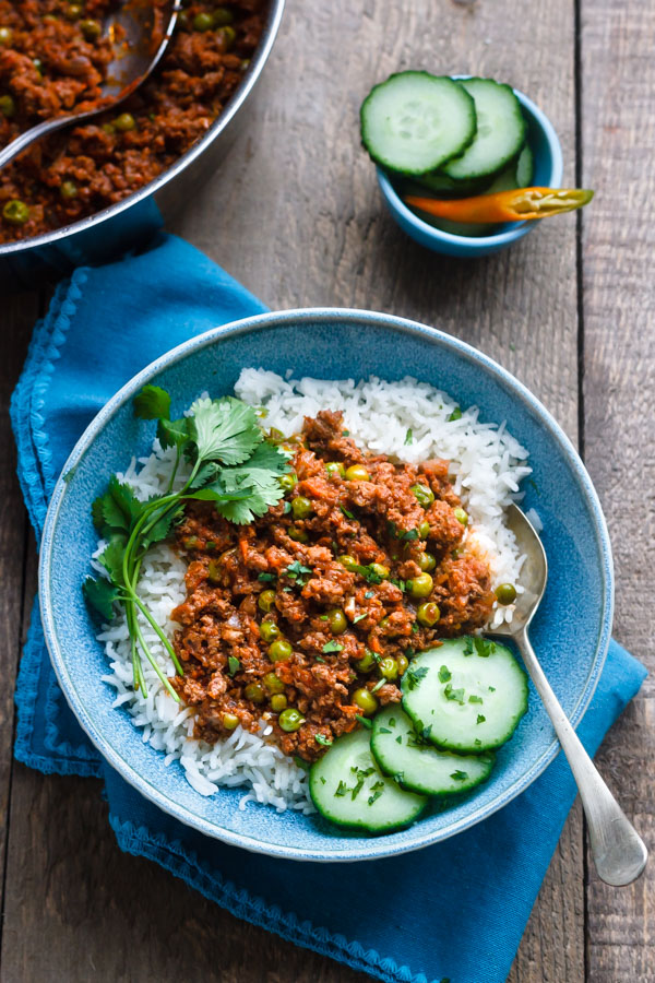 Keema curry with vegetables on top of rice