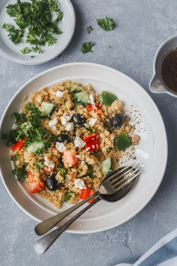 mediterranean quinoa salad with date vinaigarette on a bowl
