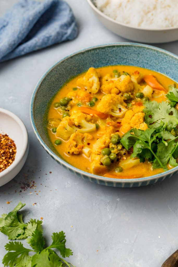 cauliflower coconut curry in a bowl with rice